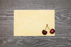 Cherry on a sheet of paper Stock Image