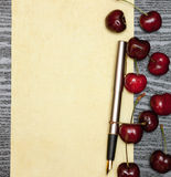 Cherry on a sheet of paper Stock Photography