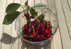 Cherry in a sieve Stock Photo