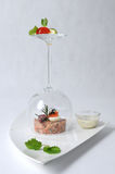 Cherry smoked salmon tartare. Salmon tatare, cherry-wood smoked, served with a honey and mustard dressing and quail eggs and complemented by Russian salmon Royalty Free Stock Photography