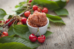 Cherry sorbet on wooden surface Royalty Free Stock Photography