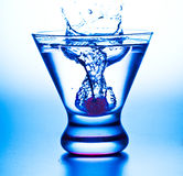 Cherry Splash.Blue Overtone Royalty Free Stock Photography