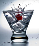 Cherry Splash on the Rocks.Black-Stem Glass Royalty Free Stock Photo