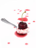 Cherry on spoon Stock Image