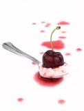 Cherry on spoon Stock Image