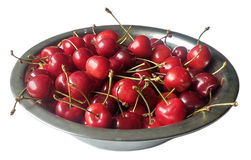 Cherry in steel bowl on white background. Cherry in steel bowl isolated on white background royalty free stock images