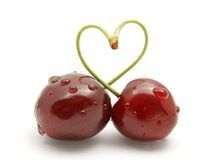 Cherry stick heart-shape Stock Photography