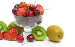 Cherry, strawberry and kiwi closeup on white background Stock Image