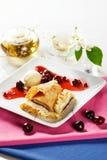 Cherry strudel. With ice cream and cherry sauce Stock Image