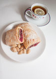 Cherry strudel with almonds. Sweet cherry strudel of puff pastry; two slices on plate stock image