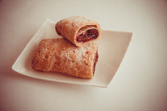 Cherry strudel with almonds. Sweet cherry strudel of puff pastry; two slices on plate royalty free stock photo
