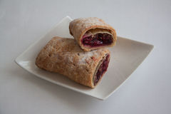 Cherry strudel with almonds. Sweet cherry strudel of puff pastry; two slices on plate stock photos