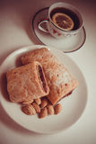 Cherry strudel with almonds. Sweet cherry strudel of puff pastry; two slices on plate stock images