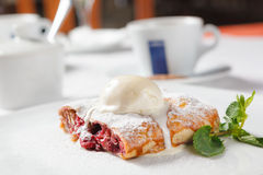 Cherry strudel with ice cream Royalty Free Stock Photo