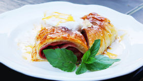 Cherry strudel with ice-cream on a white plate Stock Images