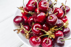 Cherry. Sweet cherry on the white wood Royalty Free Stock Photography