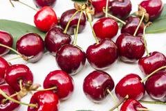 Cherry. Sweet cherry on the white wood Royalty Free Stock Photo