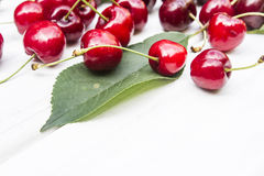 Cherry. Sweet cherry on the white wood Royalty Free Stock Images