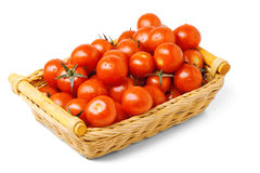 Cherry tomato. Es in a wattled basket  on the white Stock Photo