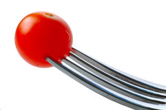 Cherry tomato. A cherry tomato on a fork royalty free stock image