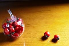 Cherry tomato in apple-shape bottle Royalty Free Stock Photos