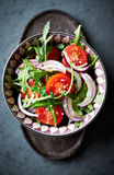 Cherry tomato and arugula salad with sesame seeds Royalty Free Stock Image