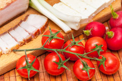 Cherry tomato with bacon, green onions, cheese and radishes Stock Photography