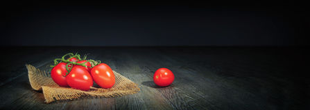 Cherry tomato. On black background Stock Image