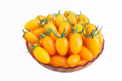 Yellow fresh cherry tomato with white background Stock Photos