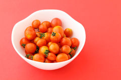Cherry tomato in the bowl Stock Image