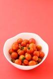 Cherry tomato in the bowl Stock Photos