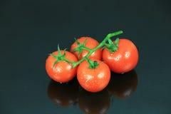 Cherry Tomato on Dark Glass Stock Photo