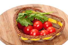 Cherry tomato and dill in a wicker basket Royalty Free Stock Photos