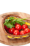Cherry tomato and dill in a wicker basket Stock Images