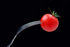 Cherry tomato with a fork Royalty Free Stock Photography