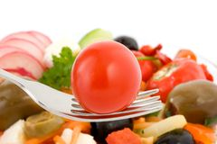 Cherry tomato on fork. Stock Images