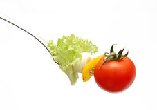 Cherry tomato on fork Royalty Free Stock Image