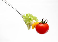 Cherry tomato on fork Royalty Free Stock Photos