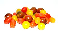 Cherry Tomato. Fresh cherry tomato fruit. White background with different colors, harvesting from home garden Stock Photo