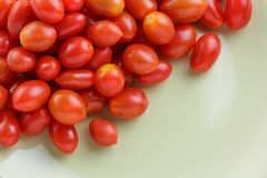 Cherry tomato on green ceramic plate . Close up cherry tomato on green ceramic plate Stock Photography
