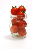 Cherry tomato in jar. Cherry tomatoes in transparent jar Royalty Free Stock Image