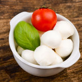 Cherry tomato, mozzarella cheese and basil leaf Royalty Free Stock Photo