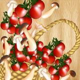 Basket of cherry tomato and mushrooms on a hardwood texture Royalty Free Stock Images