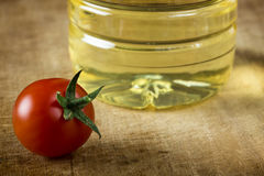 Cherry tomato and oil Royalty Free Stock Photo