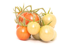 Cherry tomato over the white background Stock Images