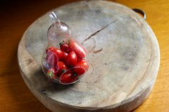 Cherry tomato in pear-shaoe bottle Royalty Free Stock Image