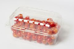 Cherry tomato in plastic container package, studio shoot on whit. Cherry tomato in plastic cointainer packed and ready for market. Package of 500g, studio shoot Royalty Free Stock Image