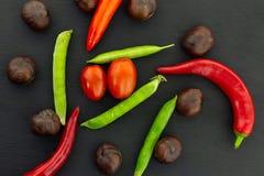 Cherry tomato pod pea chestnut chestnut many vegetable set tasty on black background contrast menu design royalty free stock photography