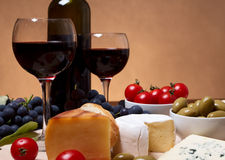 Cherry tomato, red wine and cheese. Still life with cherry tomato, red wine and cheese Stock Photography