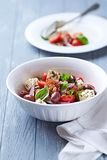 Cherry Tomato Salad with Feta Cheese and Pine Nuts Stock Photo